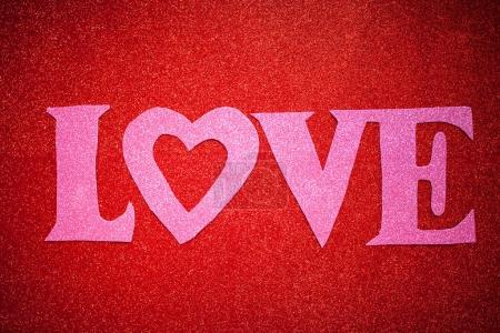 red glittery background with pink letters, love,Valentine's Day, texture abstract background, suitable for ads, insert text,