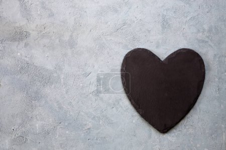 Black heart on grey background