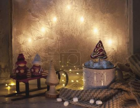 close-up of Christmas decor and mug with marshmallow and candy on festive background. Christmas concept.