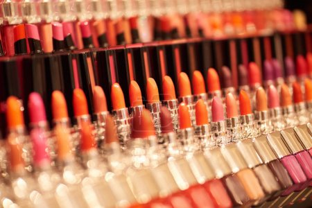 Closeup of colorful makeup attributes on shelves in store
