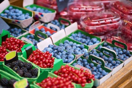 Closeup of boxes with colorful raw berries in fruits shop