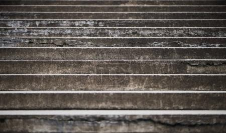 Photo for Closeup of old stairs. Dark grey textured concrete stairs background - Royalty Free Image