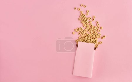 Top view of pink box of cereals on pink background