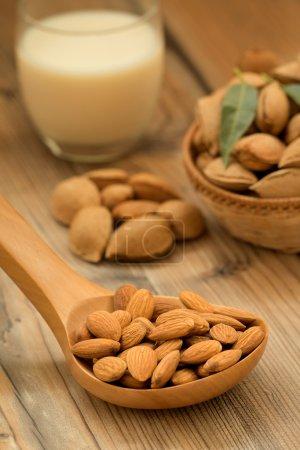 Almond milk with almonds around