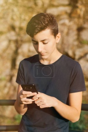 teenager with smartphone outdoors