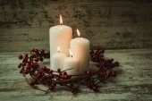 Burning candles with christmas decorations