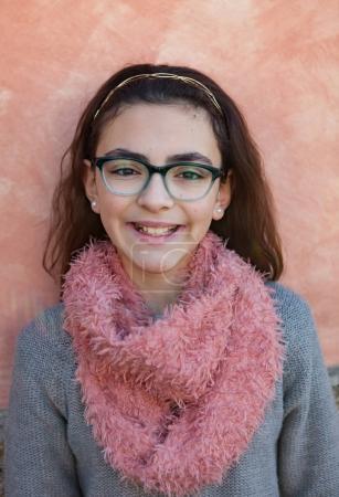 Smiling girl wearing pink scarf