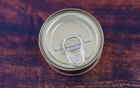 Can of preserves on rustic table