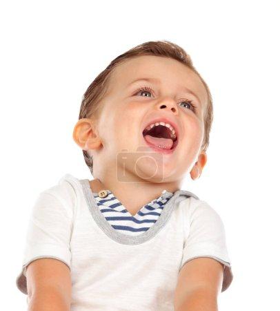 Photo pour Beau petit enfant riant isolé sur fond blanc - image libre de droit