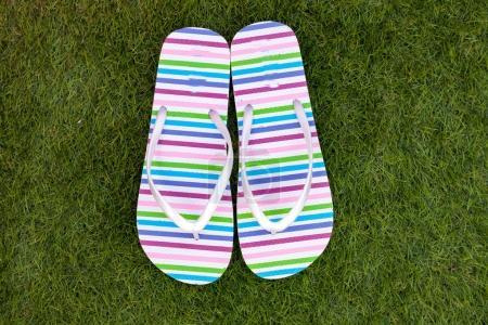 Flip-flops on green grass