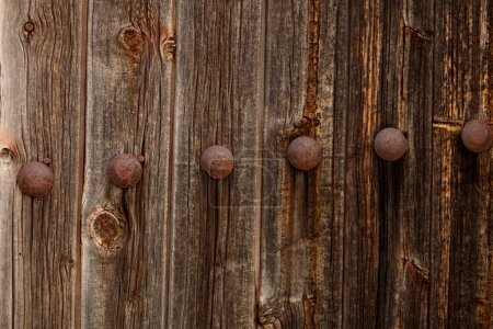 old wooden door with rusty handles for wallpaper