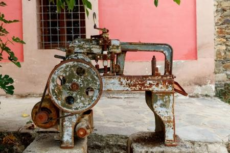 Old rusty machine located in a garden for exposition