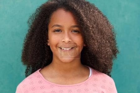 cute African American girl smiling on green background