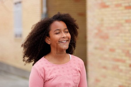 cute African American girl smiling in the street