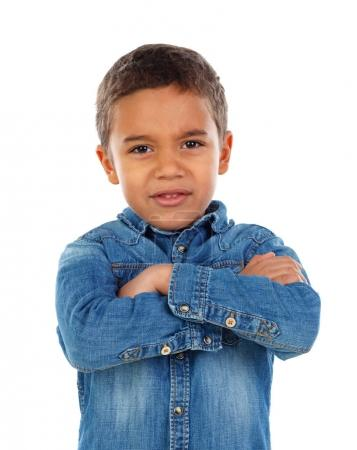 cute little African boy in denim shirt with arms crossed isolated on white background