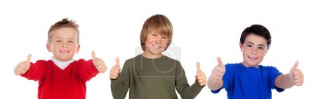 three cute little boys showing thumbs up isolated on white background