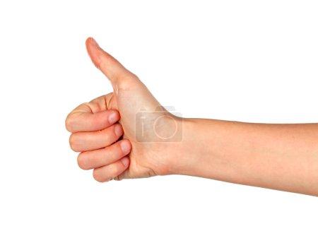 Foto de Mujer mano mostrando el dedo pulgar para arriba gesto aislado sobre fondo blanco - Imagen libre de derechos
