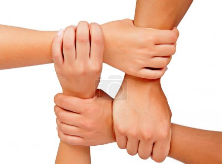 four hands together, symbol of team work, isolated on white background