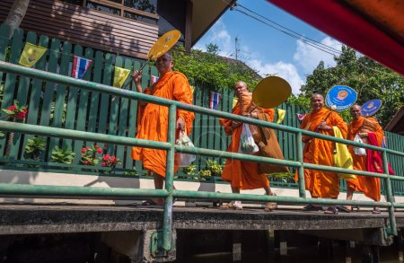 Thai monks in traditional robes