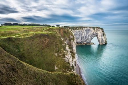 cliffs covered in grass over sea