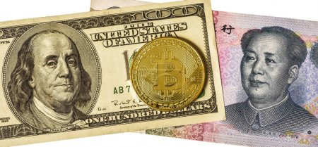 Golden bitcoin over multi currency banknotes dollar and yuan not