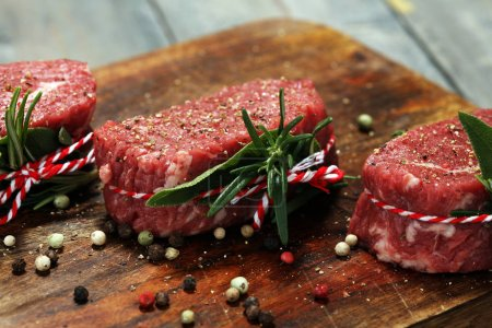 Photo for Raw beef fillet steaks with spices for bbq grilling - Royalty Free Image