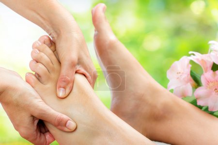 Tension relieving foot massage .