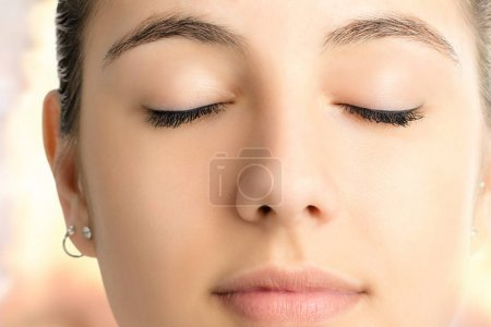 Relaxed meditating woman face