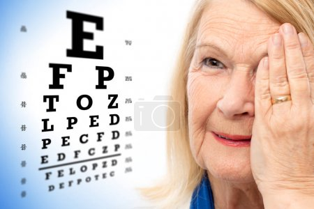 senior woman with vision test chart