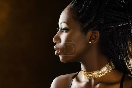 African woman wearing make up and jewelry
