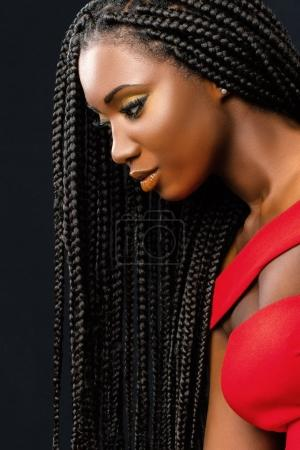 Photo for Close up vertical beauty portrait of young african woman with long braided hair against dark background. - Royalty Free Image