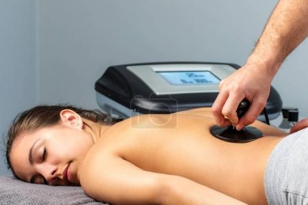Young woman having electrotherapy session.