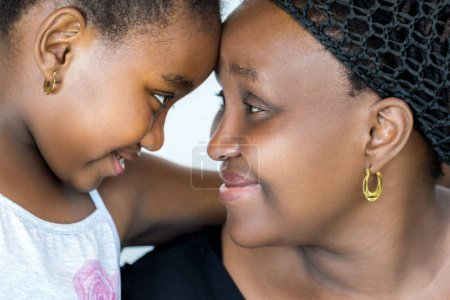 Close up face shot of african mother and little daughter