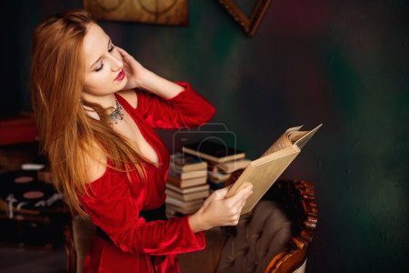 Passionate girl reading a book in luxury apartments