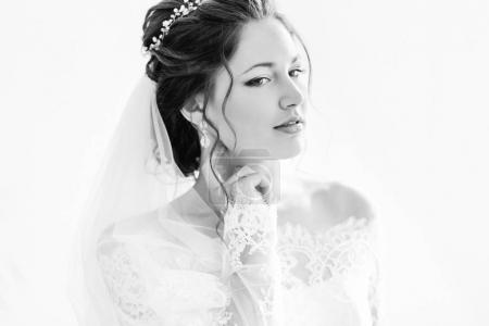 dreamed bride with a beautiful hairstyle on black and white phot