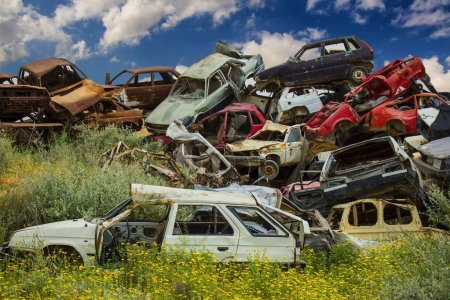 Pile of discarded old cars on junkyard