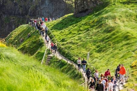 Tourists visiting Carrick-a-Rede Rope Bridge in County Antrim of Northern Ireland