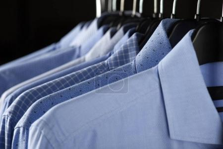Male shirts hanging in row