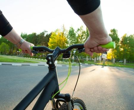 Hands on bicycle handlebars