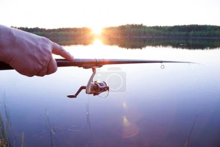 Male hand with fishing rod