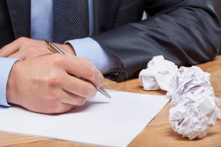 Businessman writing at workplace