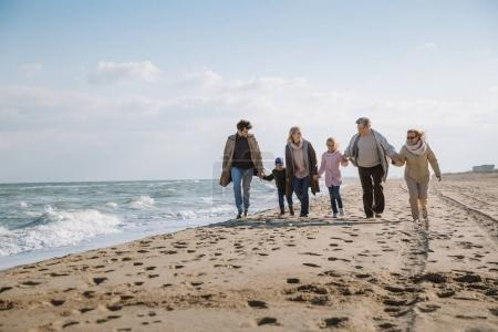 Photo for Big multigenerational family walking together on beach at seaside - Royalty Free Image