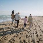 family walking at seaside