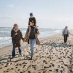 family walking together on seashore