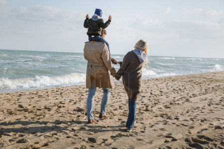 parents with son on seashore