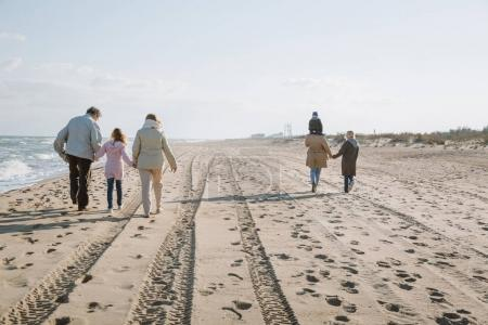 Photo for Big multigenerational family walking together on seashore - Royalty Free Image