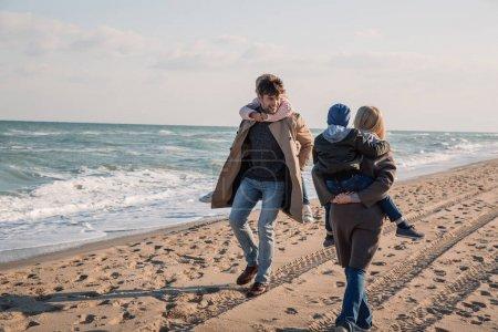 parents piggybacking their kids