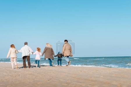 family walking at seashore