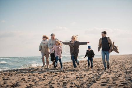 Photo for Happy multigenerational family spending time together on seashore - Royalty Free Image