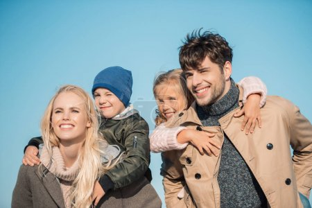 Photo for Portrait of smiling parents piggybacking their children - Royalty Free Image